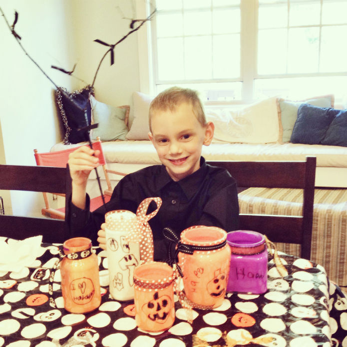 declan making halloween lanterns