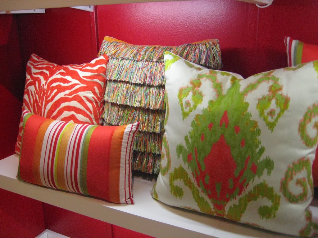 Elaine Smith Outdoor Pillows In Fiery Orange And Shades Of Emerald.