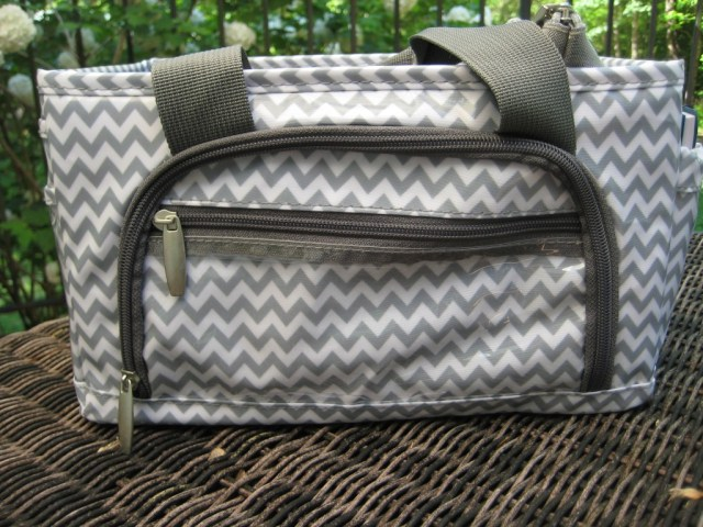 Organizer with outside zip pocket