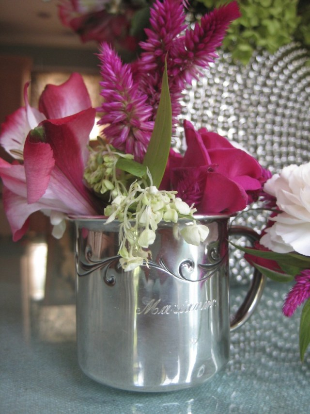 silver baby cup with flower arrangement