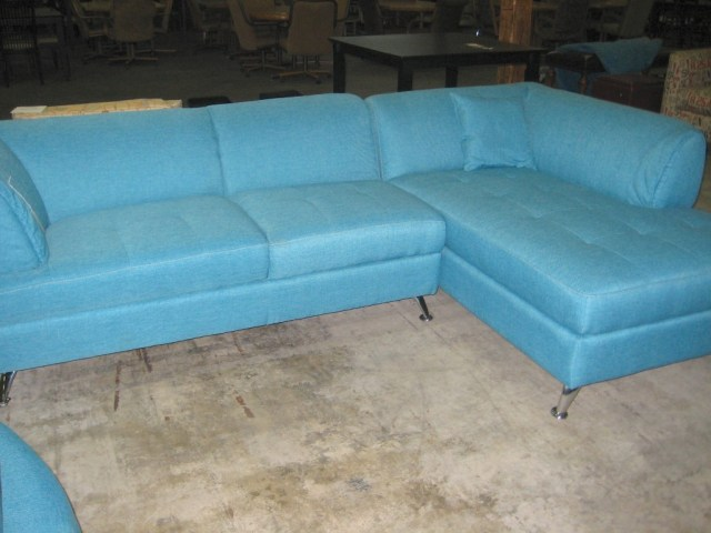 Aqua sectional with retro metal legs livingwithcolordesigns.com