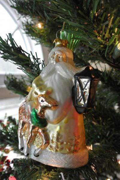 Glass ornament of Ole Saint Nick with lantern and deer - Living With Color Designs