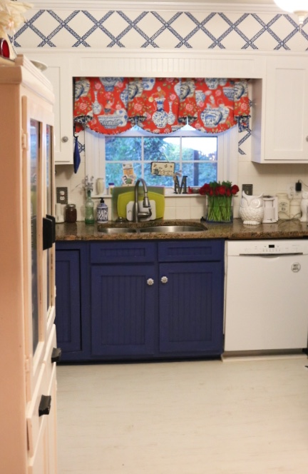 Drapery fabric with blue and white ceramics with monkeys -Blue And White Kitchen: Living With Color Designs