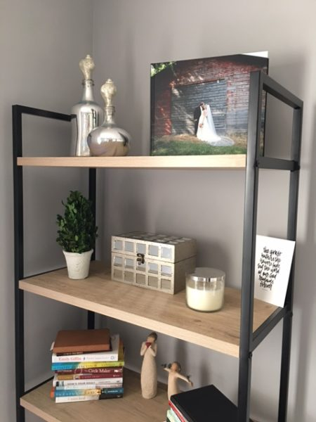 Styled bookcase - The gold lamp on the desk ia another great target find that has cool touch control. All you have to do is tap the base to turn it off and on.