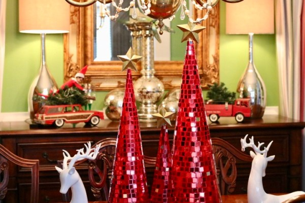 Christmas Decorating Is Easy With Cone Shaped Trees- Country Christmas with red mirrored trees, white deer, and antique toy cars and truck with Christmas tree in back