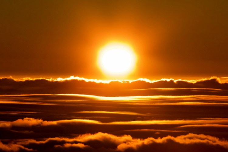 The Sun Rises Over The Clouds In Front Of The Summit Of Haleakala Volcano In Haleakala National Park On Hawaii's Island Of Maui, Sunday, Jan. 22, 2017. Park Officials Say The Sunrise On Haleakala Attracts Over A Thousand People A Day, Resulting In An Overload Of Visitors And Creating A Safety Hazard. As A Result, Anyone Wanting To See The Sunrise On The Summit Will Now Be Required To Make Reservations In Advance And Pay A Small Fee. (AP Photo/Caleb Jones) ORG XMIT: NY301