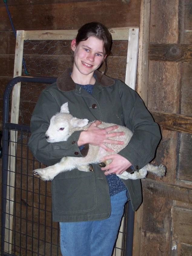 Emily Cradles a New Lamb