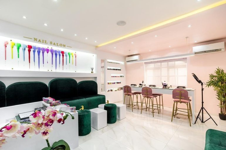 Nailicure nail salon by Ocubed Designs features a high contrast interior colour scheme
