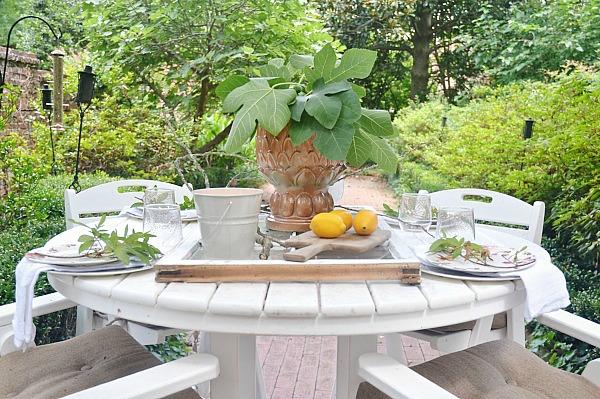 Inspirational Summer patio table with a window table runner u DIY outdoor chandelier lizmarieblog