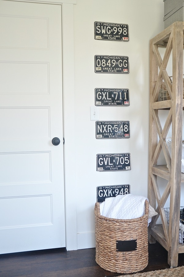 License plates hung on the wall from Liz Marie Blog #gallerywall #decorating #decoratingideas #andersonandgrant