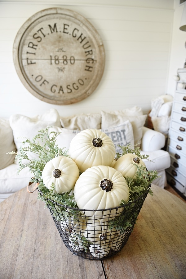 Basket of pumpkins neutral fall centerpiece