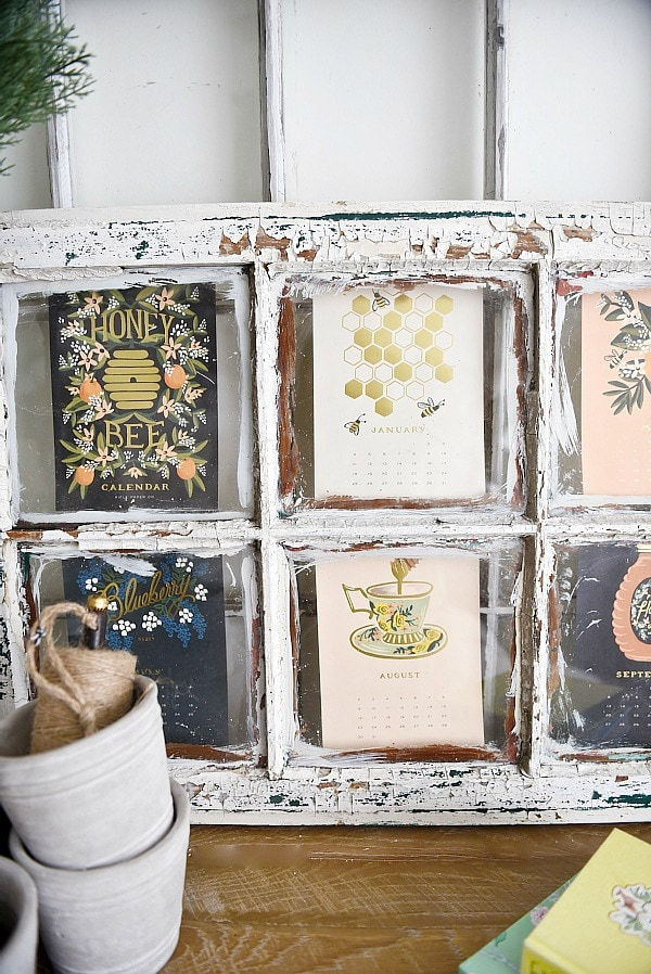 DIY recycled calendar art - A great way for 'FREE' art & a way to recycle last years calendar. Could be displayed in so many different ways. This one uses an old window.