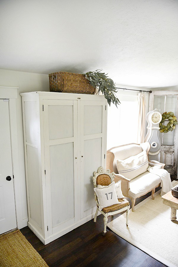 Entryway armoire - a great way to add storage to an entryway. If the closet is too small or if there isn't a closet an armoire adds amazing storage that you can hide away the mess!