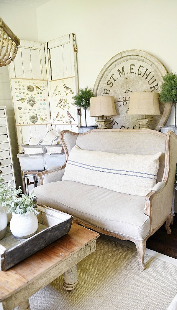 DIY Bi-fold doors in the living room to cover a wall vent. Great Farmhouse decor inspiration. & a great way to cover a wall vent!