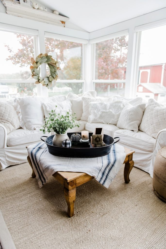 a farmhouse style coffee table in the