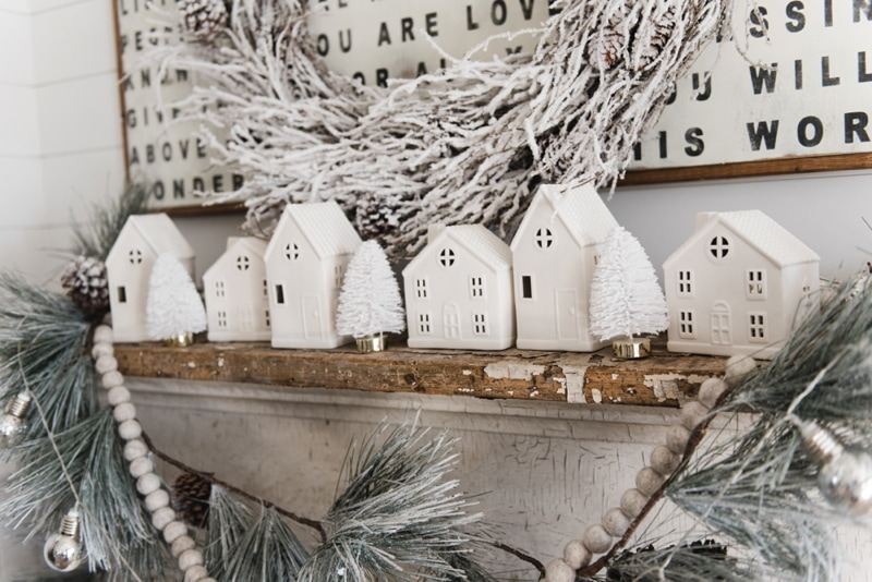 Farmhouse Christmas Village Mantel - Target dollar spot christmas village houses. A great rustic farmhouse mantel & christmas decor inspiration.