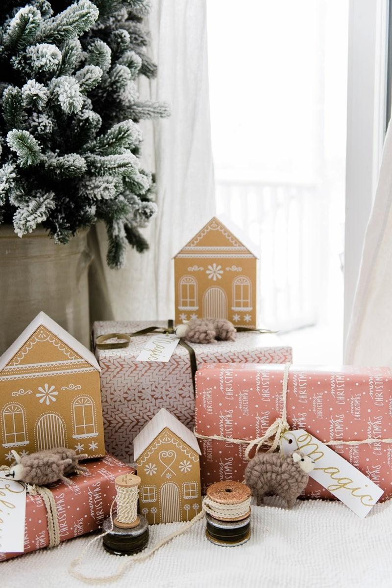 Farmhouse Gingerbread House Gift Wrap - Check out this rose gold gingerbread house gift wrap - a great pin for farmhouse & cottage style Christmas decor inspiration.