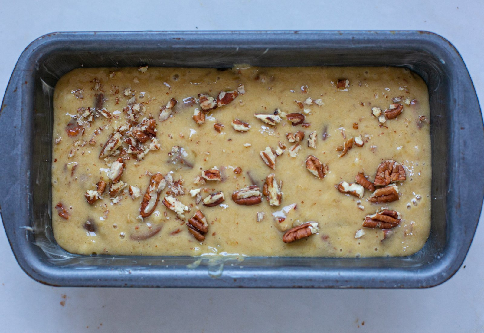 Chocolate pecan banana bread mixture in a loaf tin ready to bake