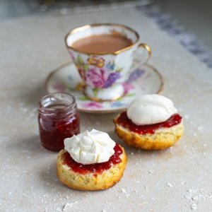 freshly baked fluffy buttermilk scones served with jam and fresh cream