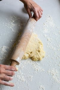 Buttermilk scone mixture being rolled out on a floured surface