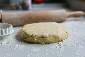 Rolled buttermilk scone mixture on a floured surface