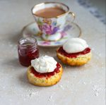 Freshly baked buttermilk scones served with jam cream and a cup of tea