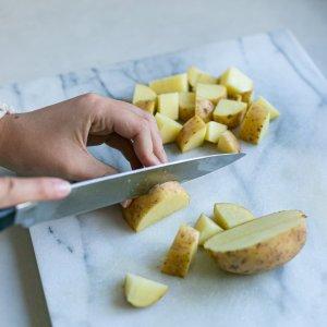 chopping potato for easy homemade oven chips