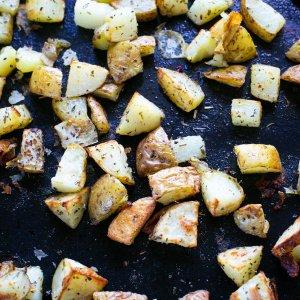 freshly roasted easy homemade oven chips on a baking sheet
