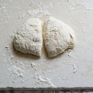 Knocked back baguette dough ready to roll