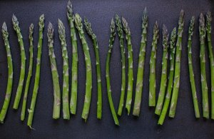 asparagus spears on a baking tray