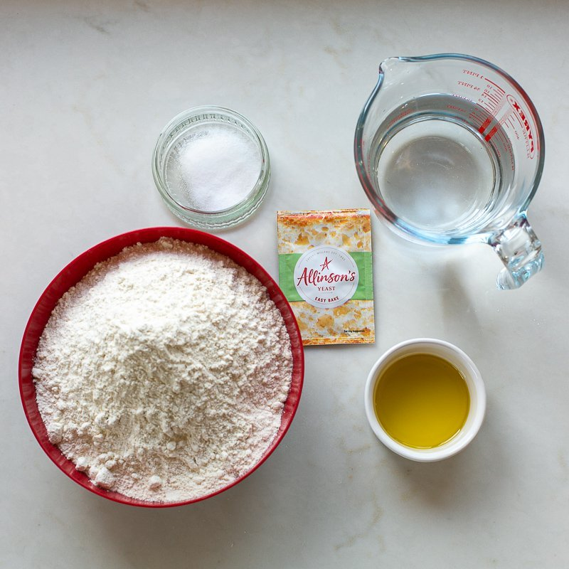 Ingredients for bloomer bread loaf on a kitchen work surface