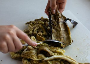grilled Aubergines being skinned to add to baba ganoush