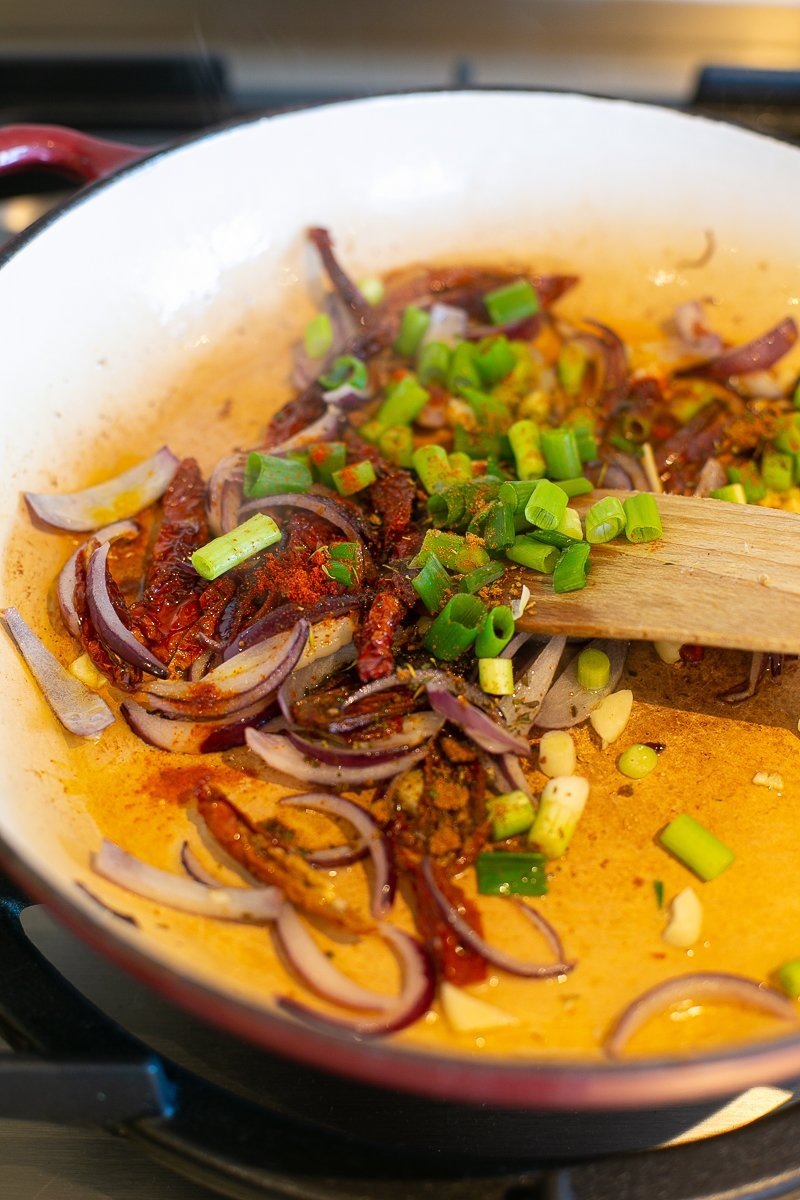 Vegetables and spices cooking in a pan to make special rice
