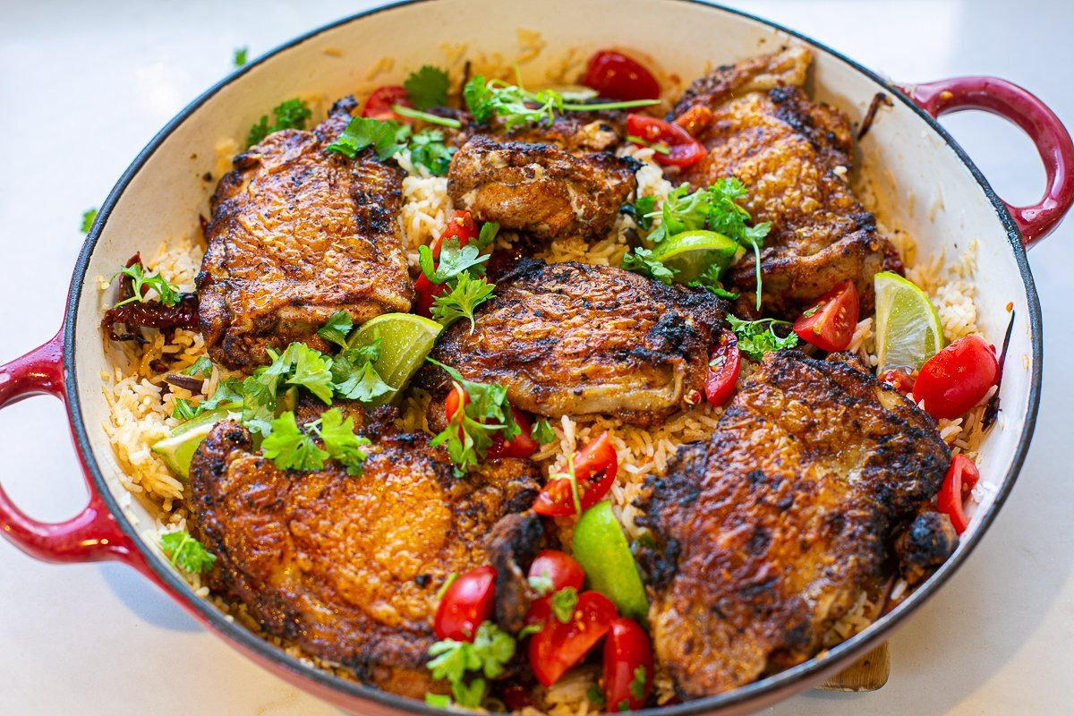 cooked marinated chicken thighs served with special rice