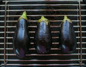 pricked aubergines ready to grill for baba ganoush