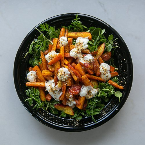 Carrot and nectarine salad served with yoghurt and dukkah dressing