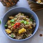 pork and pineapple stir fry in a bowl