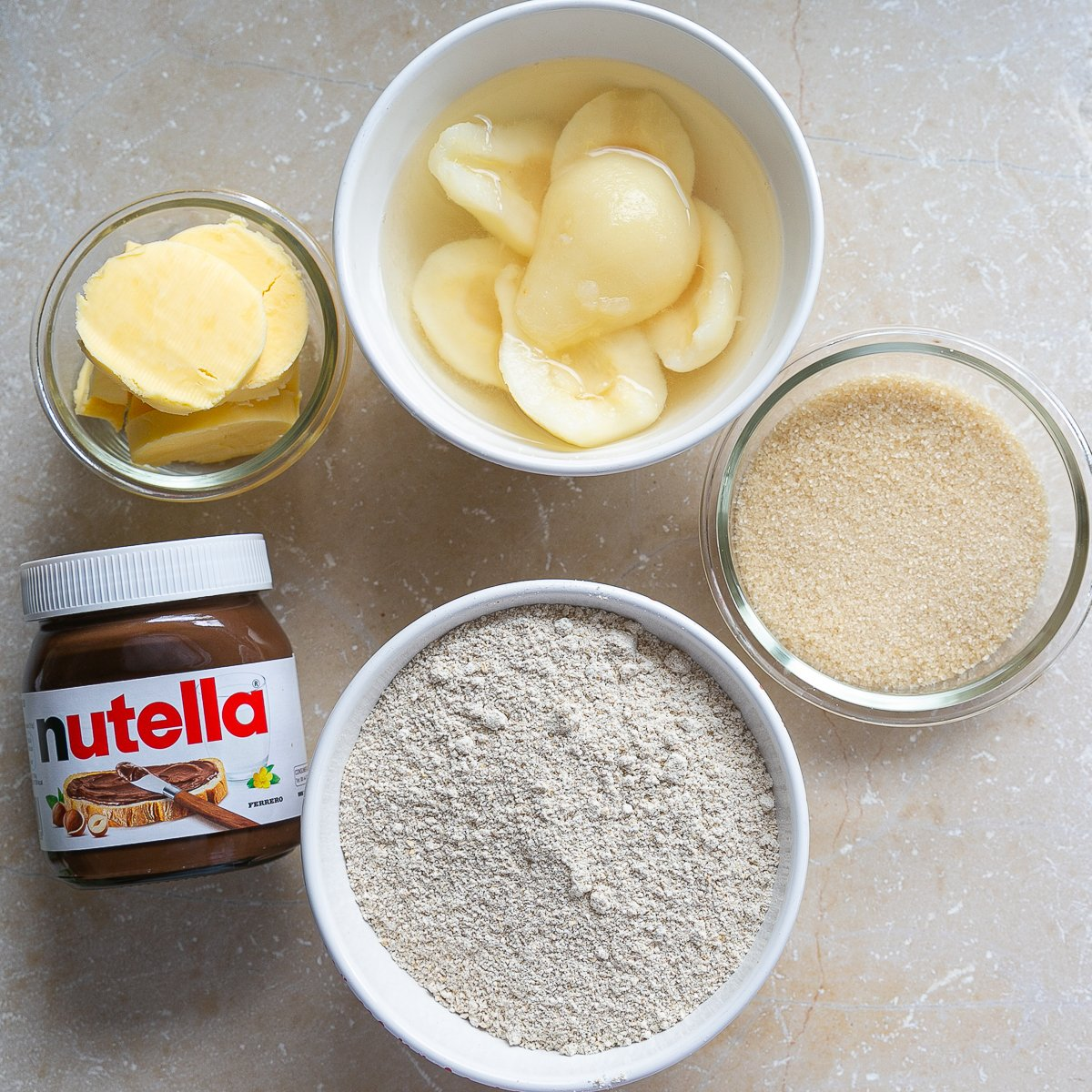 all the ingredients needed to make oaty pear and chocolate crumble