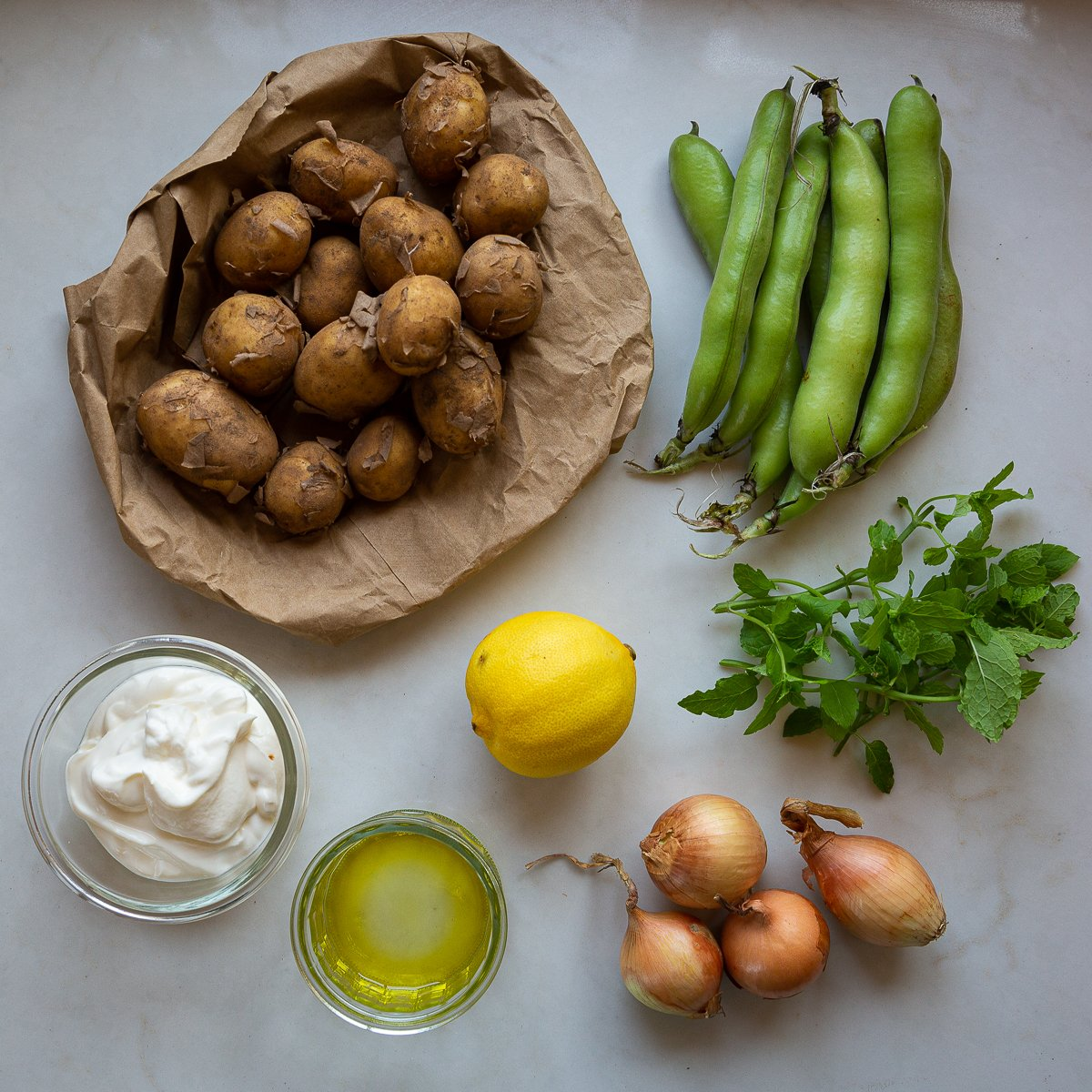 All the ingredients needed to make Light broad bean potato salad