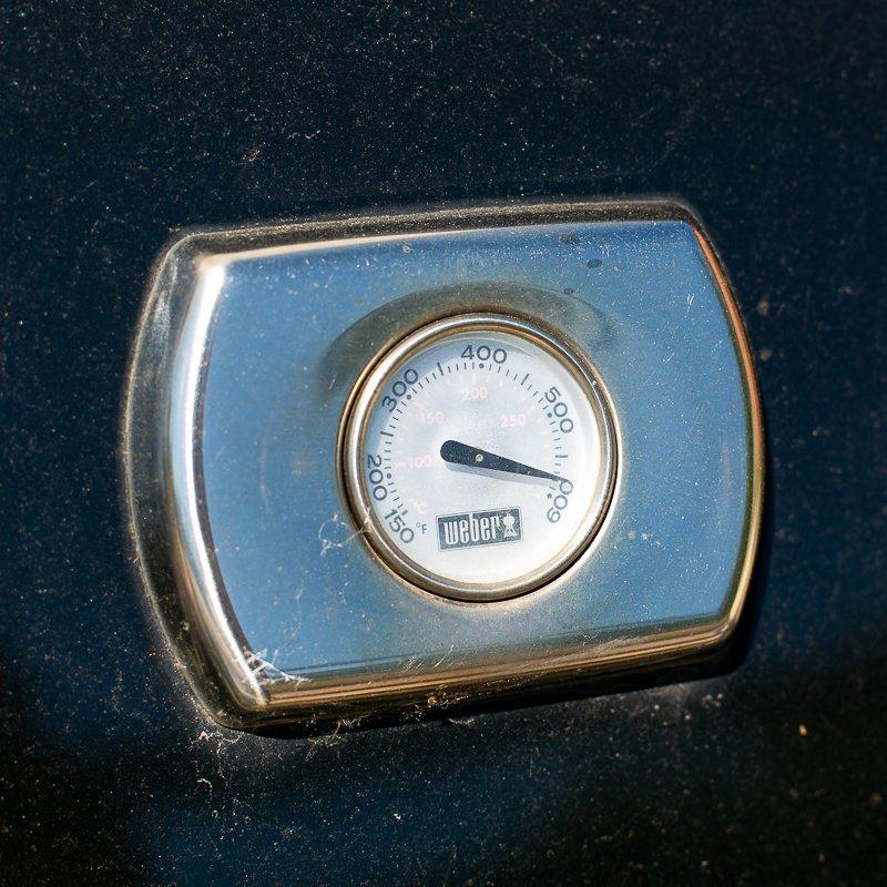 A Weber gas BBQ gauge showing 600F