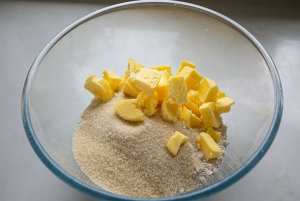 oat flour, sugar and chopped butter in a bowl