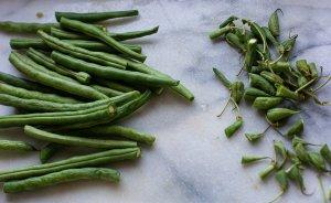 chopped green beans on a chopping board