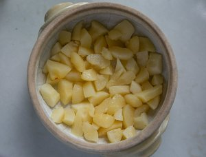 Chopped tinned pears in the bottom of a crumble dish