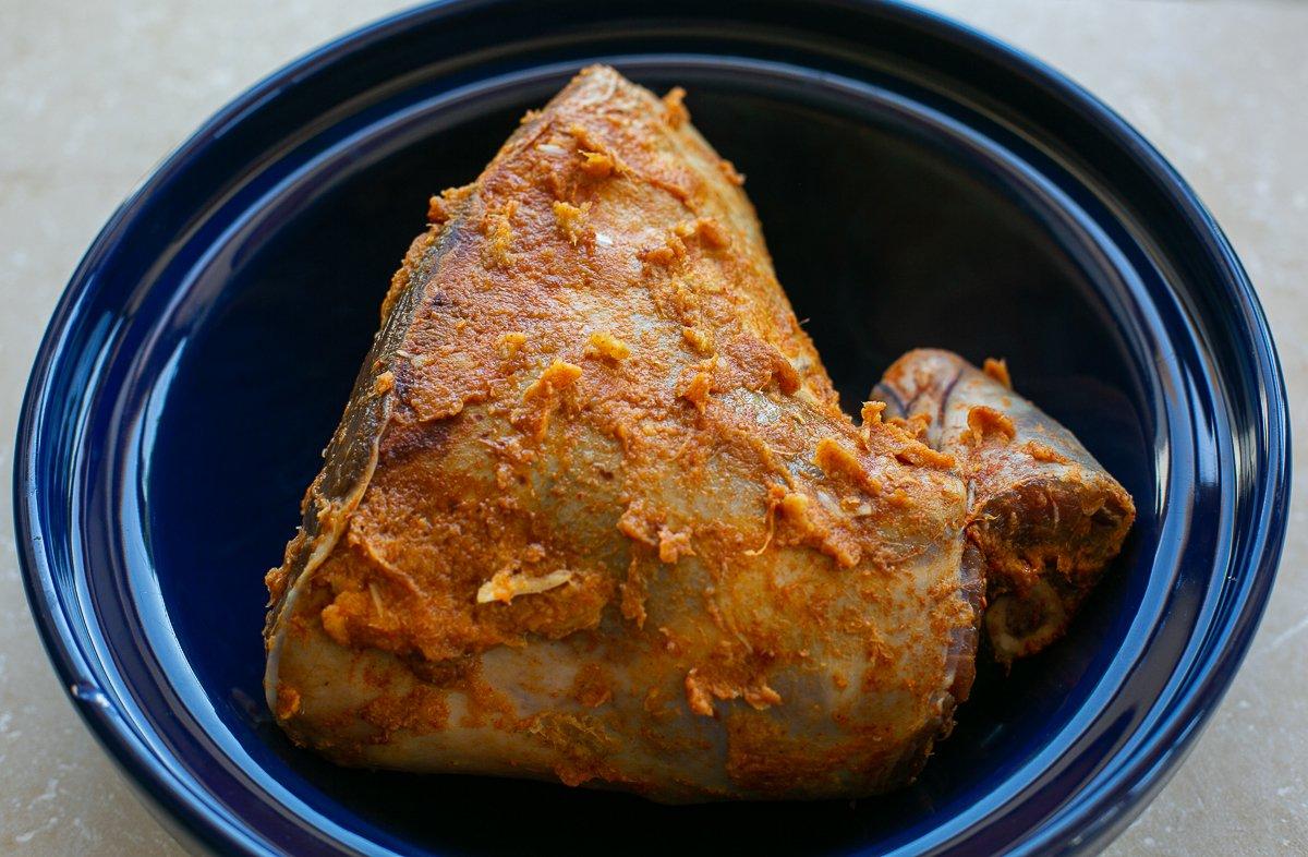 a marinated lamb leg in a tagine pot