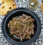 Dishoom's Lamb Raan served with naan bread and kebab masala