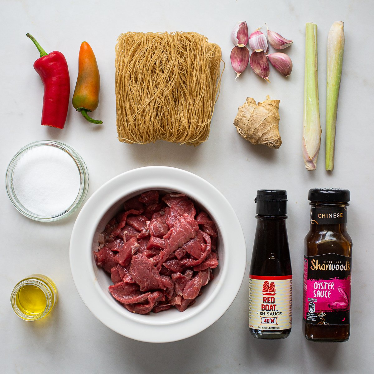 all the ingredients needed to make vietnamese beef noodle bowls