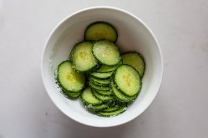 pickling cucumber slices in a bowl