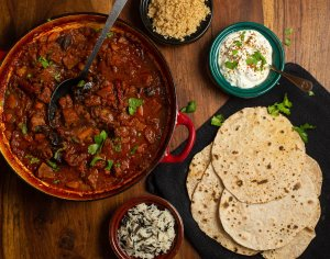 middle eastern beef stew served with couscous and flatbreads
