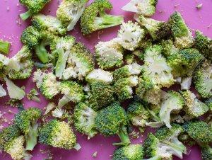 chopped broccoli on a chopping board