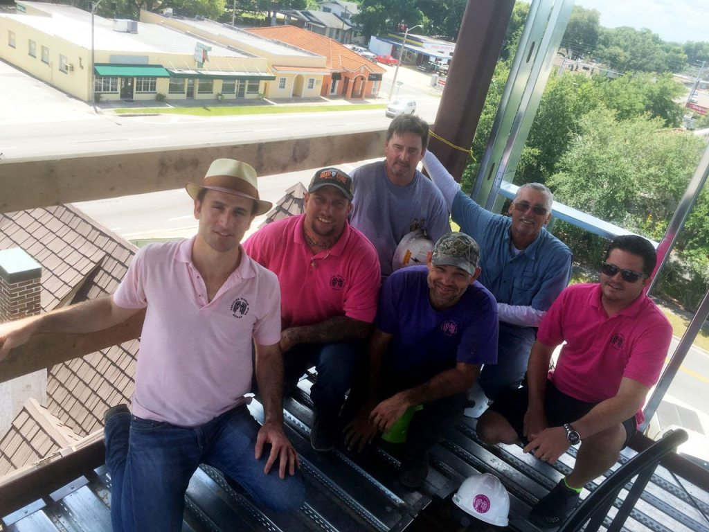 Fancelli, left, poses in the tower over the Tudor House with members of his team, including Adam Earley, Scott Adams, Robert Lewis, construction supervisor Albert Moore and property manager Grant Miller.